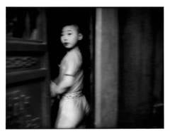 Suspicious glance from a young theatrical performer, Beijing, China