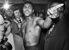 Muhammad Ali menacing Joe Frazier before rematch, Madison Square Garden, NY, Jan