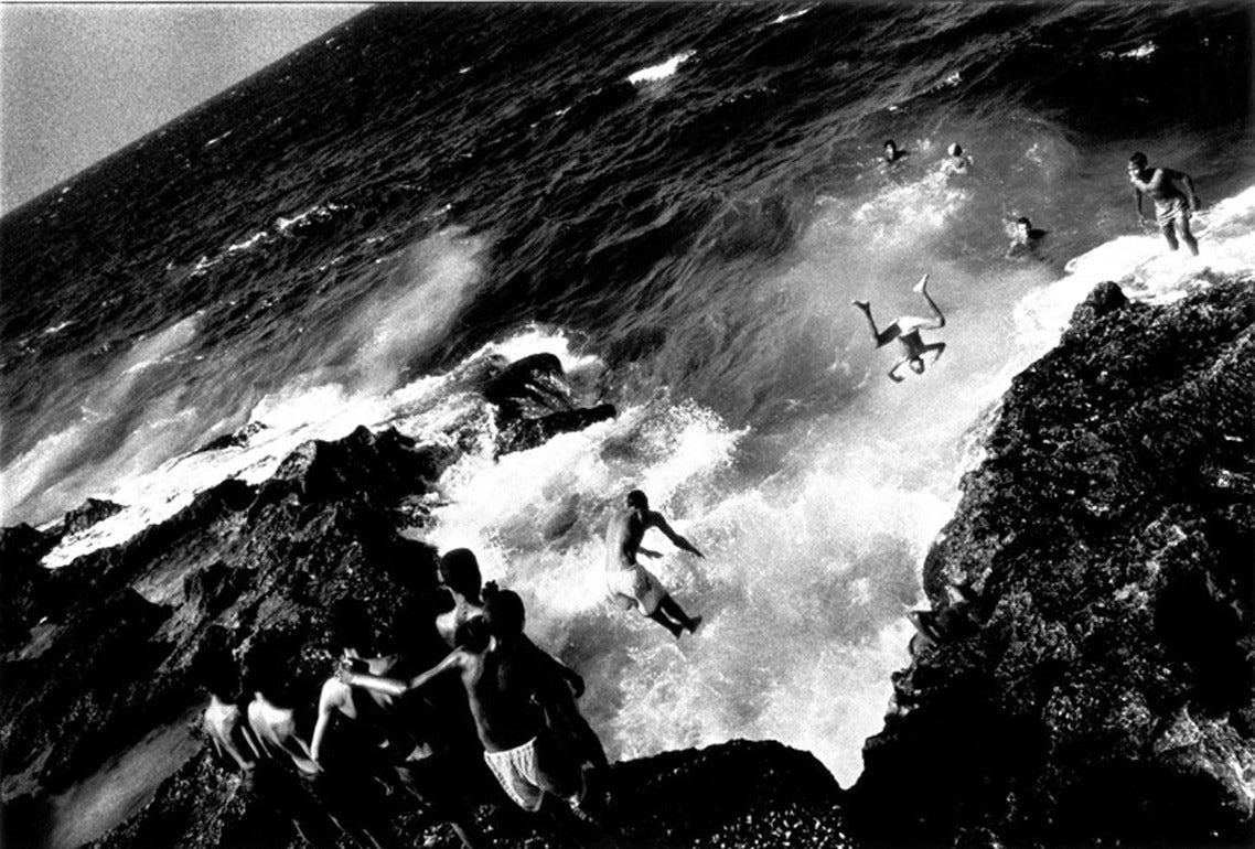 Boys jumping off the Malecon, Havana