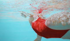 """Water Colors"" Woman Swimming in Red Bathing Suit with Reflections on Water"