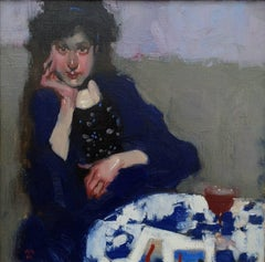 """Monique and her Japanese Prints"" portrait oil painting of a woman in blue coat"