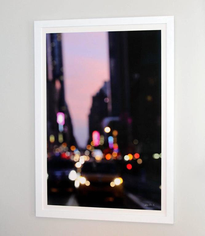 It's Going Down is a limited edition color photograph.  It is 40x27.  The edition size is 10.  The color photograph is signed and number.  It is framed with a plexifacemount. It is a New York cityscape filled with light, skyscrapers and