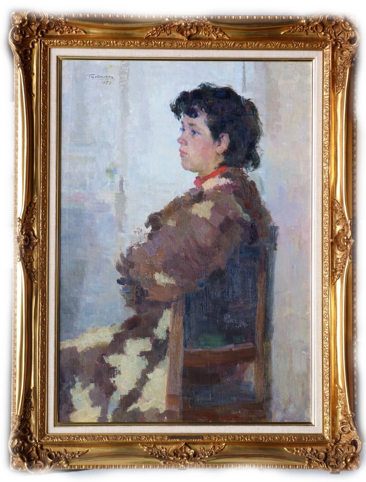 Portrait of a child sitting on a chair