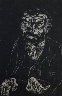 Portrait of a Man with Hands on Table