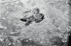 Photograph of Marilyn Monroe Swimming by Lawrence Schiller