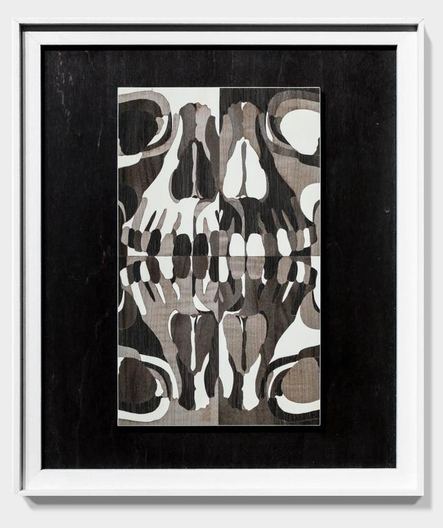 """""""Human Skull"""" is an original hand-cut wood collage by Matt R. Phillips.  The piece ships in the pictured, artist-made, wood floater frame and measures 14""""h x 12""""w.  Matt R. Phillips is a contemporary artist working in the field"""