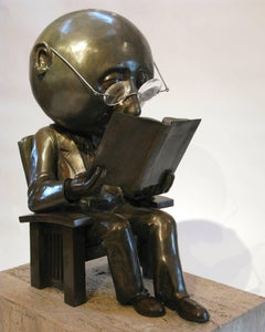 The Reader, bronze man in Stickley chair reading book, thick glasses