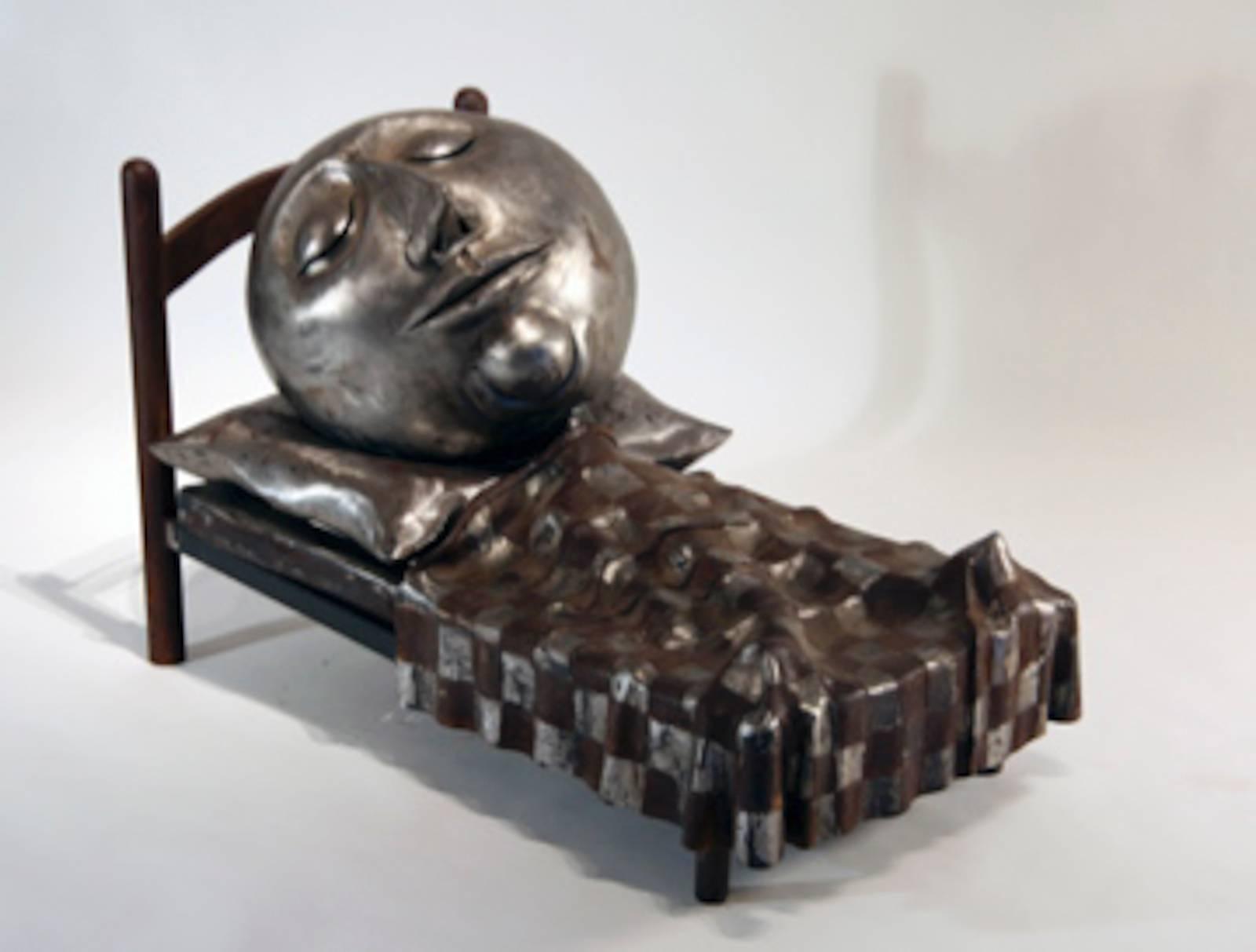 Slumber by Rodger Jacobsen fabricated steel sculpture sleeping man in bed humor