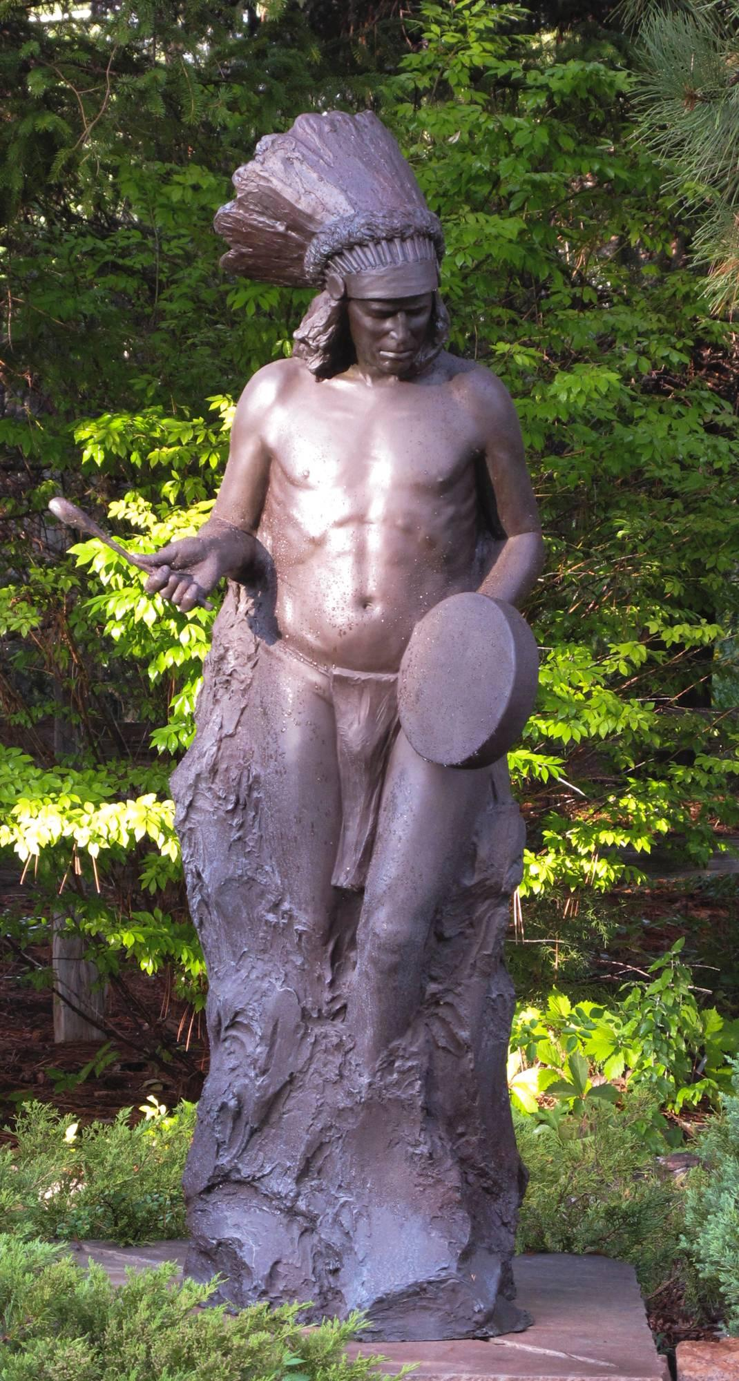 Beat of the Drum Paul Moore bronze Native American man with Drum, headdress