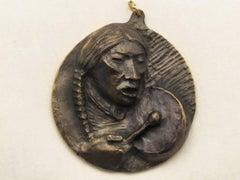 Plains Drummer medallion bronze by Allan Houser Apache