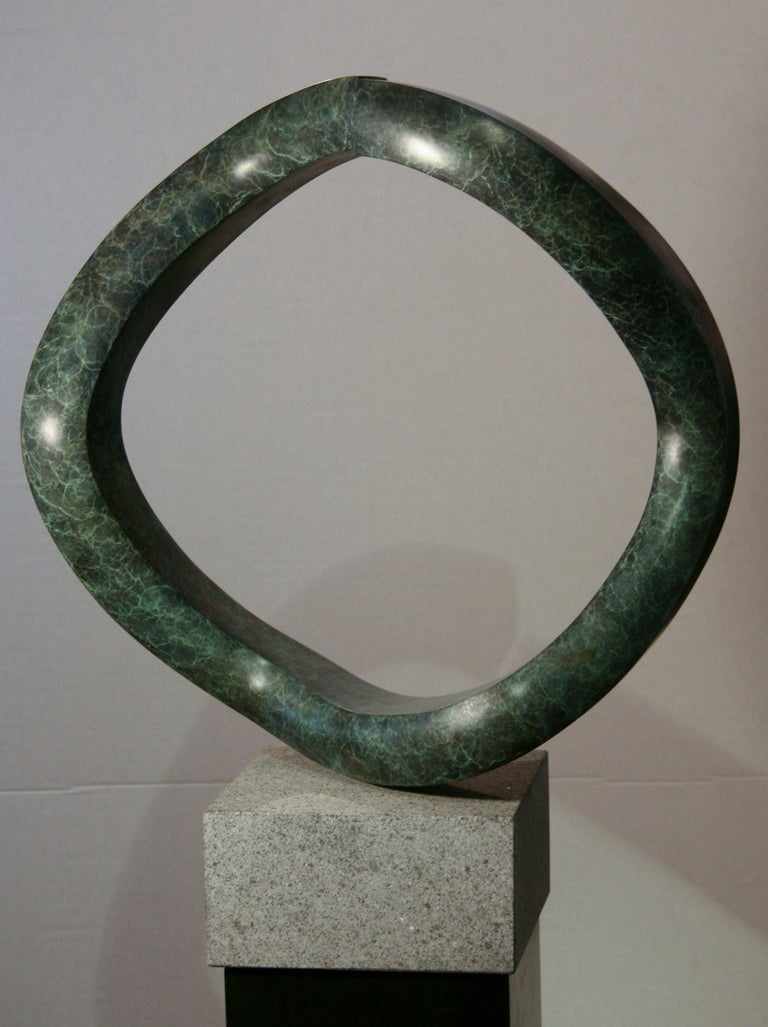 Oh, rotating bronze sculpture, shape appears to change when moved