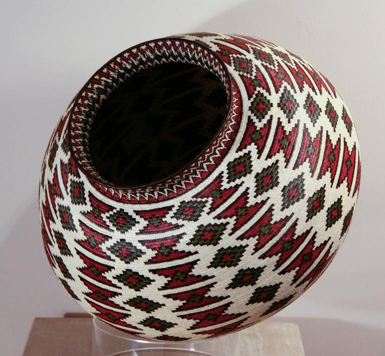 Rain Forest Basket Panama by Ana Cabezon, finely woven,red,green,black geometric Rain forest baskets  The baskets are made by the Wounaan and Embera Indians from the Darien Rainforest in Panama.  The Wounaan believe they emerged from the palm tree.