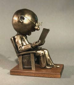 The Reader (small), gold bronze sculpture, reading book, glasses,Rodger Jacobsen