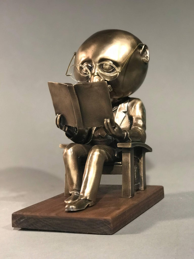 The Reader (small), gold bronze sculpture, reading book, glasses,Rodger Jacobsen  registered, numbered, edition 100  University of Tulsa Library has one of the larger sculptures in its permanent collection.  A well-known sculptor, Jacobsen has