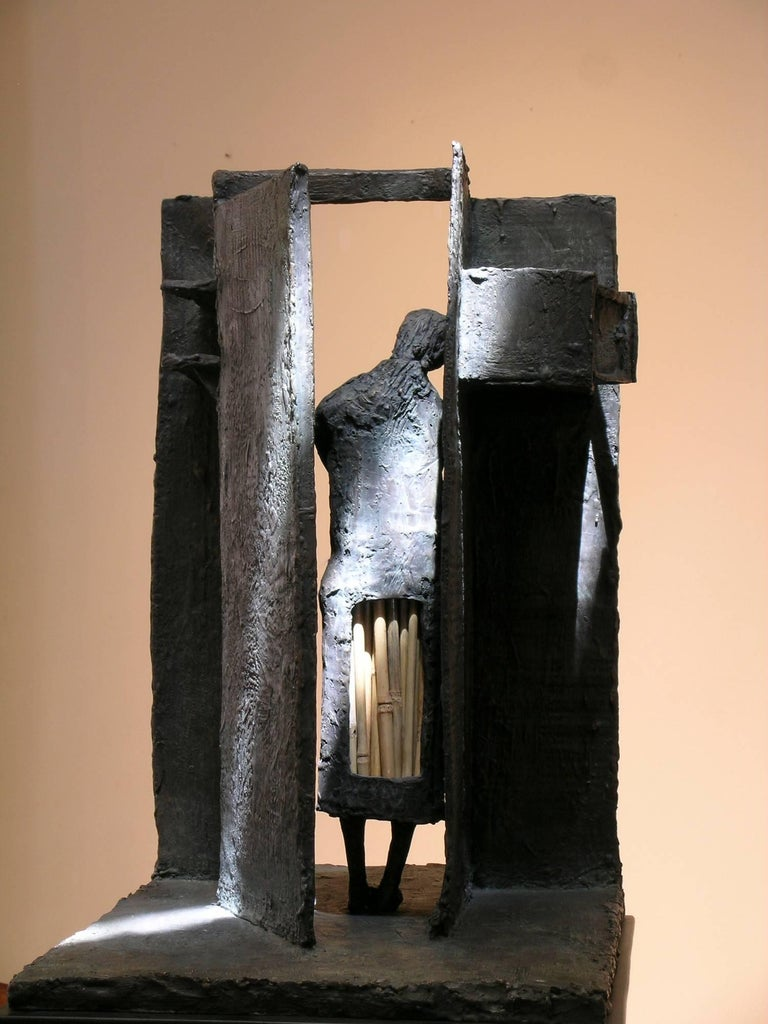 Empty Cupboard (Alacena Vacia), bronze and straw sculpture, Eduardo Oropeza  bronze sculpture with straw  In my hollow abode I wait for you, oh soul of hope, that you can be so bold. In the hour when famishment is my faithful companion, I search the