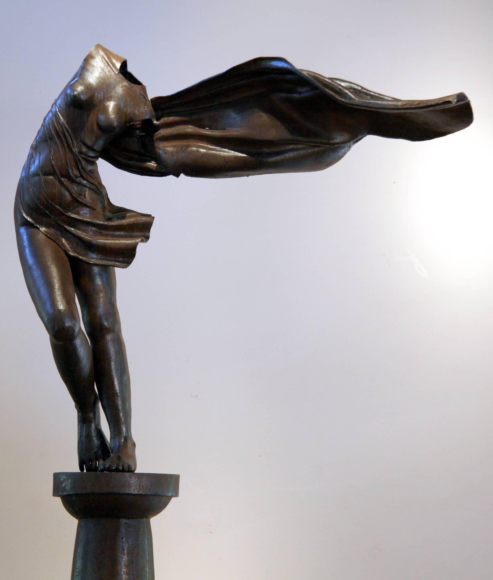 Long Gone by Rodger Jacobsen female nude bronze sculpture, stone base, contempor