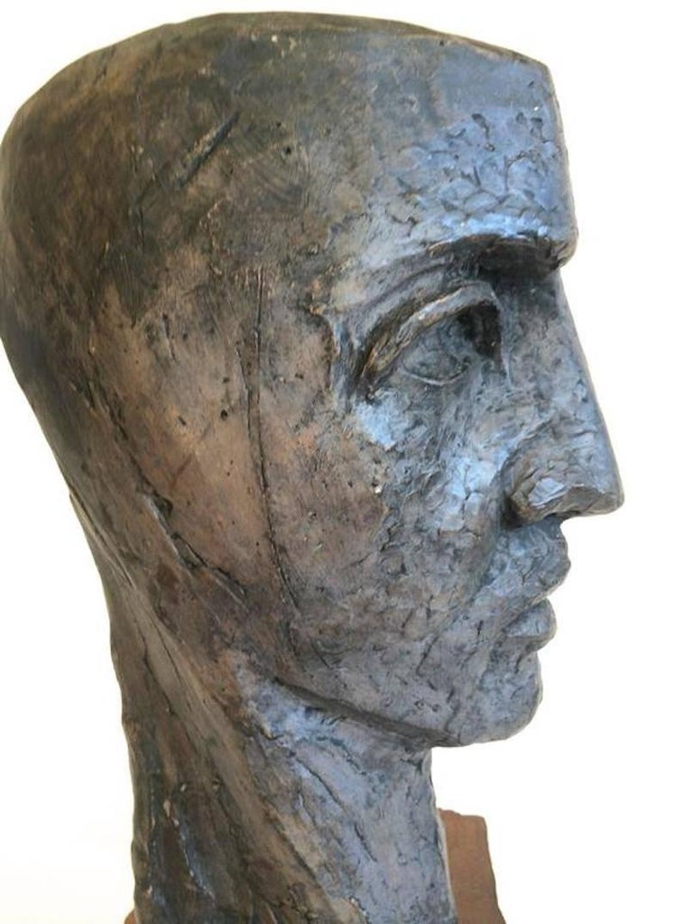 Black/gray Head of a Man Clay Brutalist style sculpture, wood stand signed. Size:18.5 x9x8  Donald Odysseus Mavros was born in New York City on 4 March 1927-2010. He studied in New York and became a ceramic designer, sculptor, painter, and teacher.