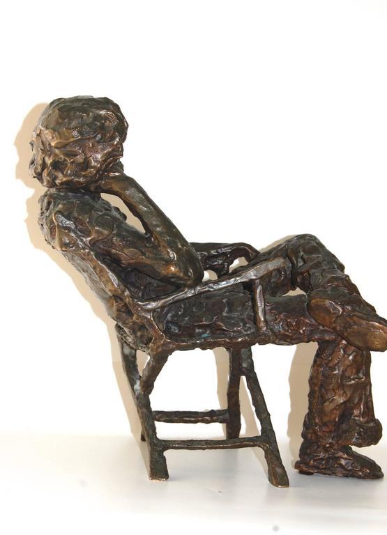 Boobis Chanin Man Seating In The Folding Chair Bronze