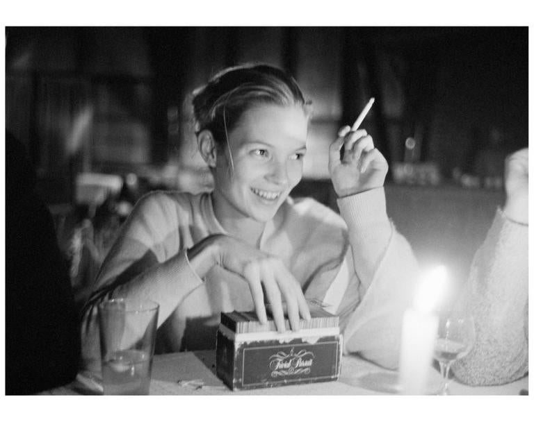 Arthur Elgort Black and White Photograph - Kate Moss playing Trivial Pursuit