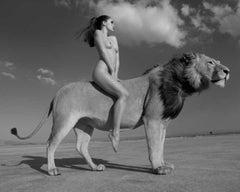 Angela rides the lion