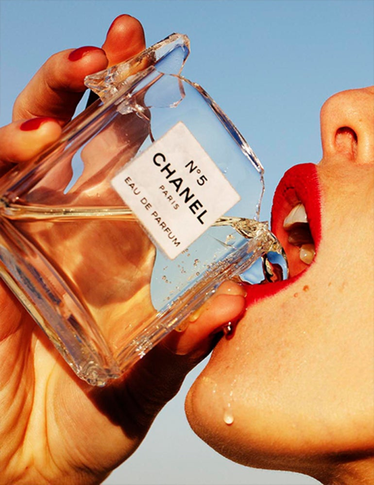 Hot Shot - portrait of a model with red lips drinking Chanel No 5 perfume