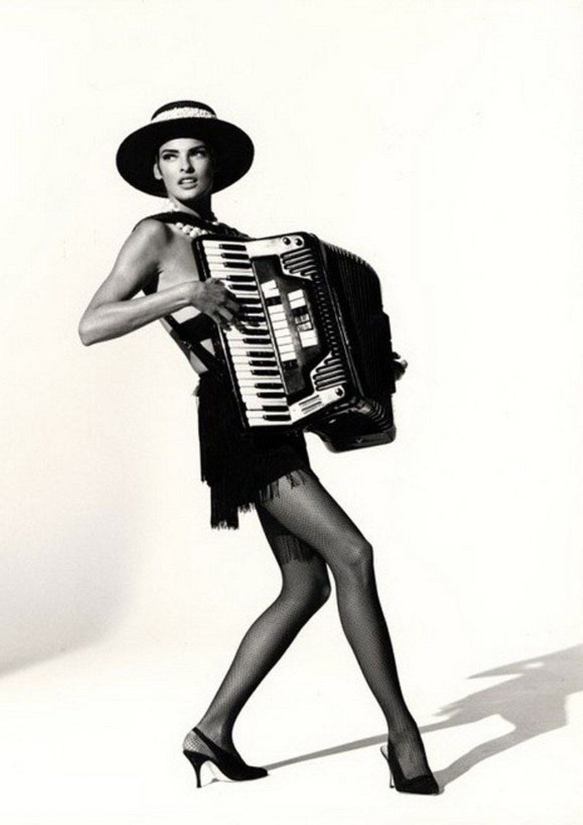 Arthur Elgort Black and White Photograph - Linda Evangelista playing