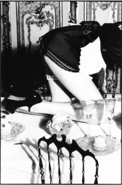 Maid - crawling over a set dinner table in vintage look