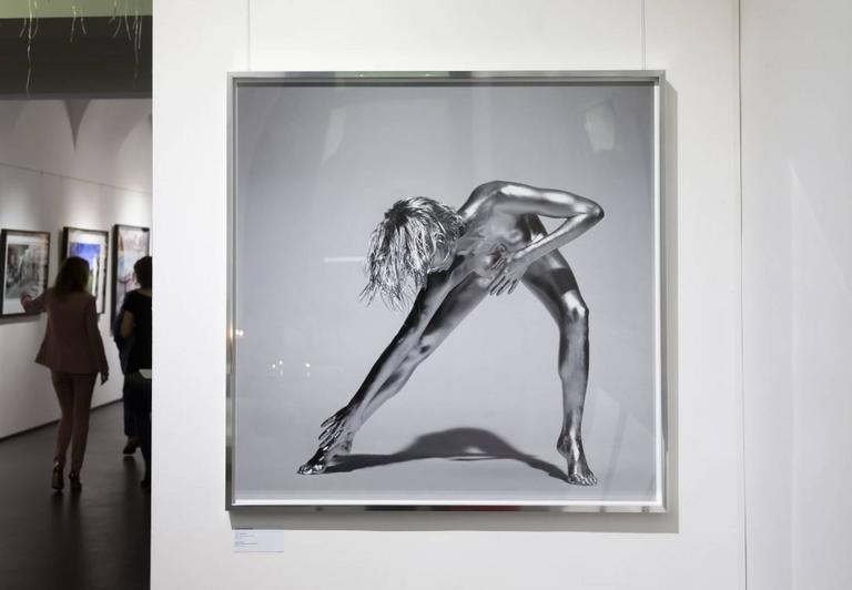 Classical silver nude picture of a model and dancer stretching - from the Argentum series inspired by antique goddesses and sculptures.  PREISS FINE ARTS is one of the world's leading galleries for fine art photography representing the most famous