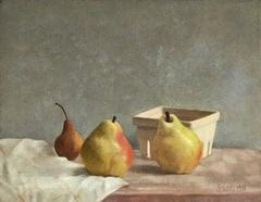 Pears on white cloth