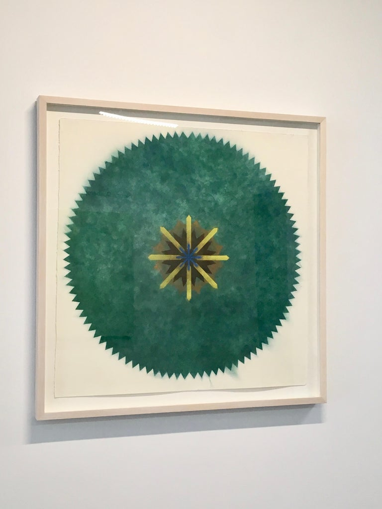 This multicolored drawing has a beautiful, soft mottled texture created with Judge's unique powered pigment technique. Pop Flower 51A-B is a predominately green mandala shape with a bright yellow, black, brown, green and blue center creating an