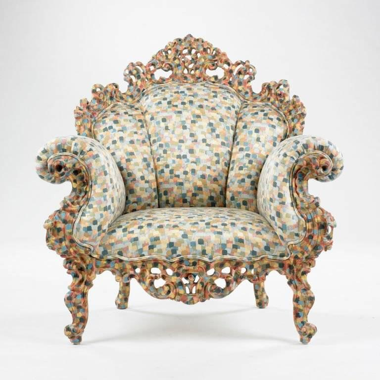 "The ""Proust"" armchair, with hand-carved and hand-painted wooden frame, is upholstered with fixed multicolor fabric matching the colors of the structure. It is a re-edition of one of the historic pieces of contemporary Italian design.  The chair is"