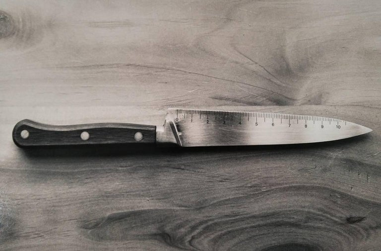 Chema Madoz Black and White Photograph - Cuchillo, Madrid (knife-ruler)