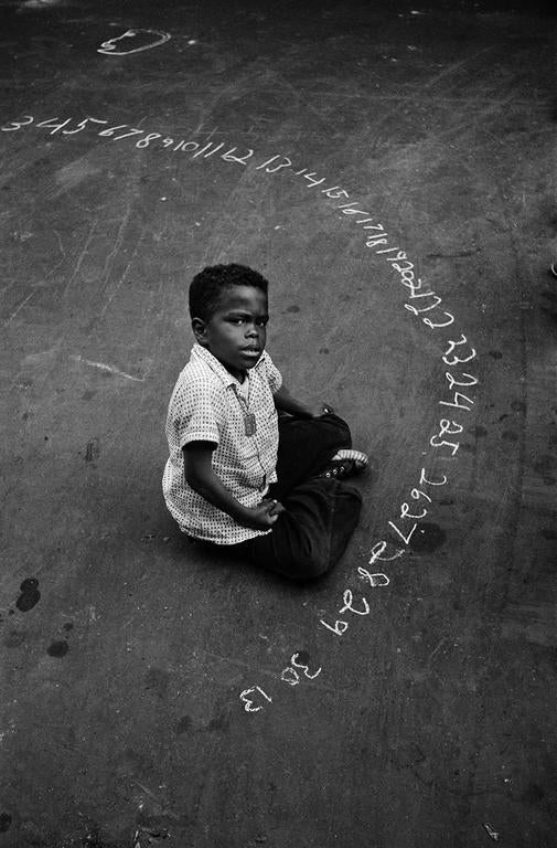 Boy with Chalked Numbers, NYC