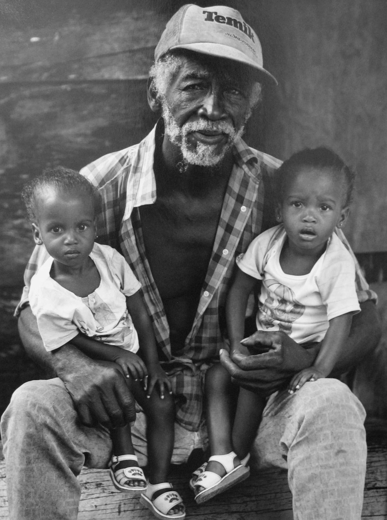 Earlie Hudnall Jr. Black and White Photograph - Man with Twins, Belize