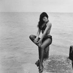 Bettie Page, Seated on Pier, Miami Beach, FL