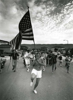 Bill Owens - Untitled (Parade Woman Holding Flag)