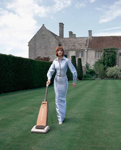 Untitled (Model Hoovering the Lawn)