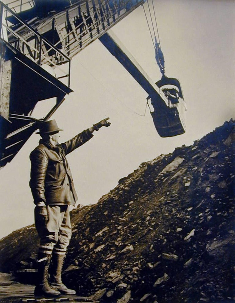 William Rittase Black and White Photograph - Untitled - Man directing steam shovel