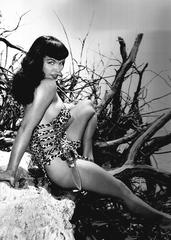 Bettie Page with Knife seated on Driftwood, Miami Beach, FL