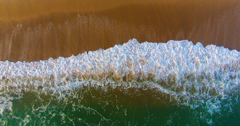 Aerial view of the beach, wave