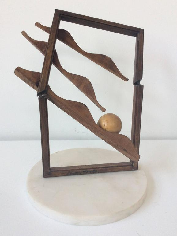 Small, mid century modern style abstract wood sculpture 12 x 6 x 2 inches, wood and marble base  Small standing vertical table sculpture constructed of wood with a marble base.  The top part of the sculpture swings back and forth if touched and