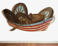 Row Boat (Mixed Media Wooden Wall Sculpture of Wagon Wheels & American Flag)