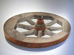 Horizontal Wheel: Mixed Media Brown Wooden Wheel 3-D Wall Sculpture