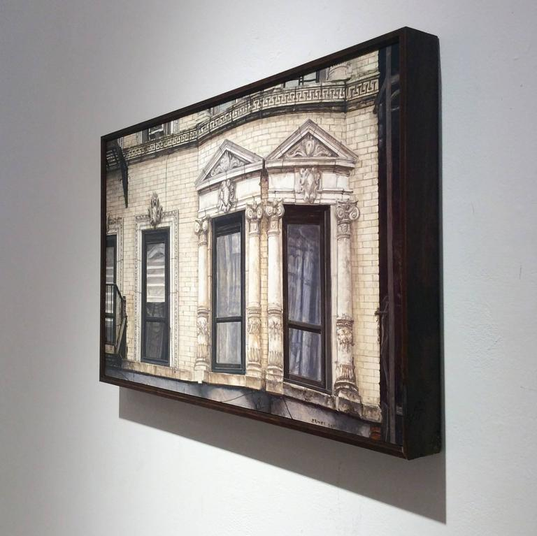 oil on wood in artist made frame 12 x 18 inches  $1,800  This contemporary, realistic oil painting of a New York City building was painted by Richard Britell in 2017. Employing his mastery of the troupe l'oeil technique, Britell paints the light