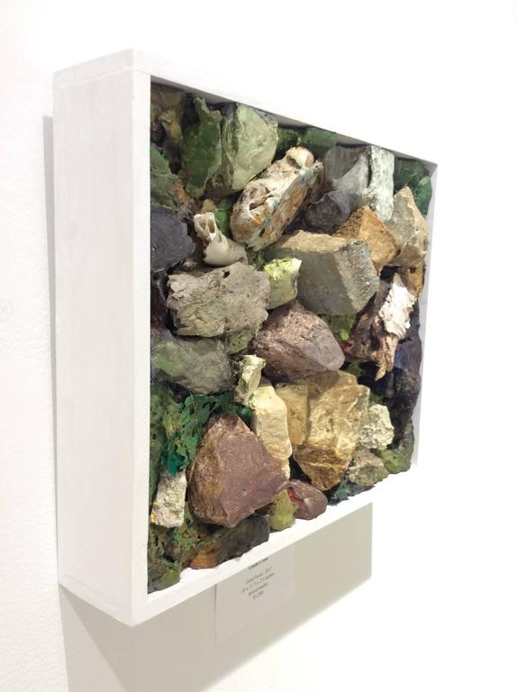 mixed media on panel in white wood frame 10 x 11.5 x 2.5 inches  This contemporary mixed media wall sculpture was made by Hudson Valley based artist Linda Cross. Here, carved styrofoam and other materials are arranged into an abstracted vignette