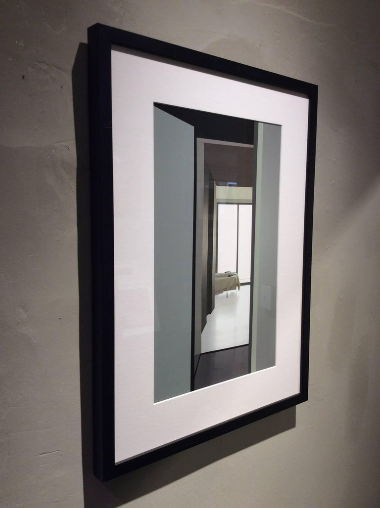 Archival inkjet print 24 x 18 inches in black exhibition frame and white mat  This manipulated inkjet photograph by Western Massachusetts-based artist Stephanie Blumenthal, offers a glimpse into a minimalist bedroom. A neutral taupe, bold white,