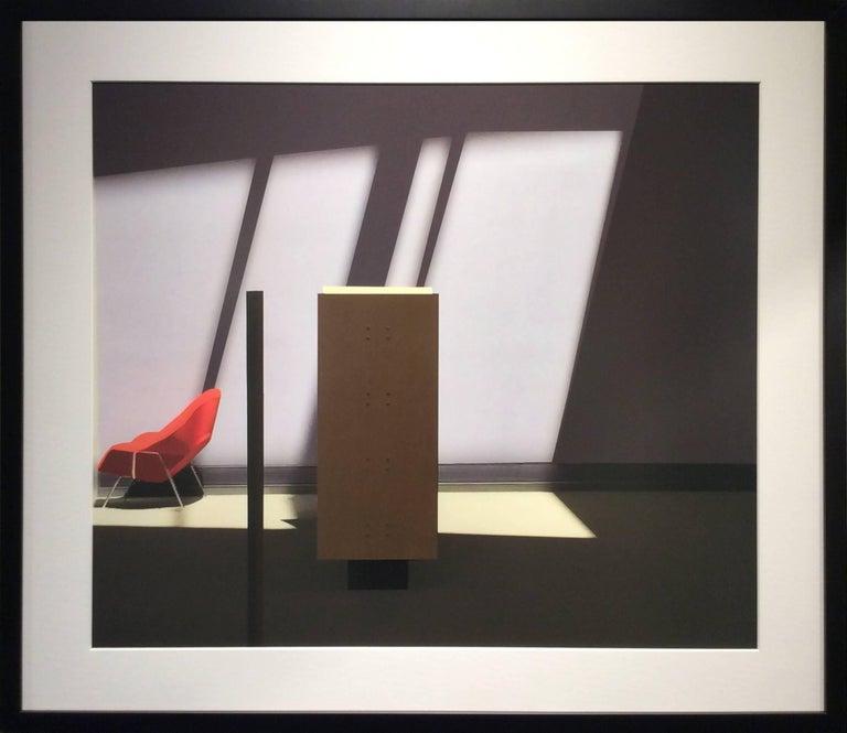Red Chair (Modern Abstract Inkjet Print of Minimalist Interior in Black Frame) - Photograph by Stephanie Blumenthal