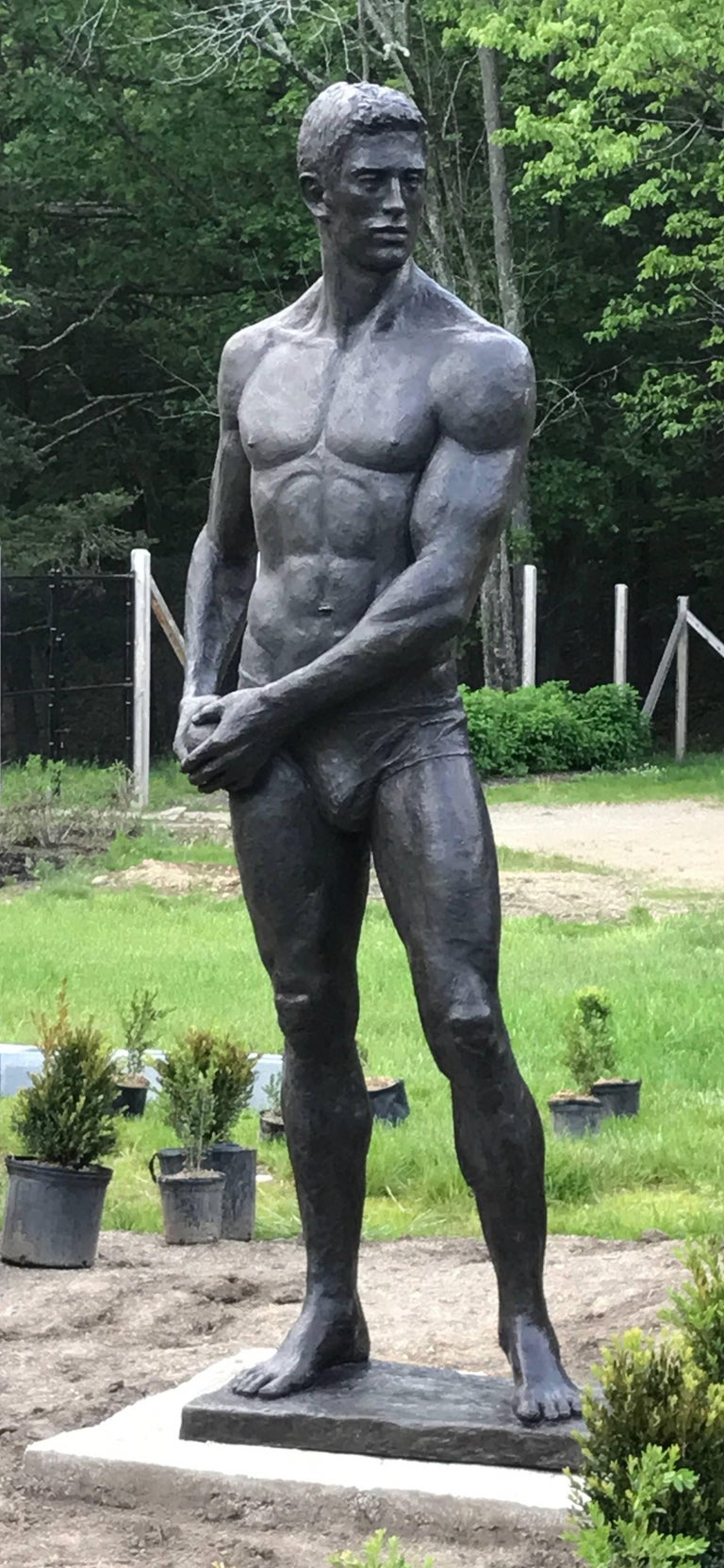 modern figurative bronze sculpture of a nude athlete  8.5 feet tall and measures 36 inches at the widest point bottom base measures 31.5 x 17.5 inches This sculpture is offered by Carrie Haddad Gallery, located in Hudson, NY.  This figurative bronze