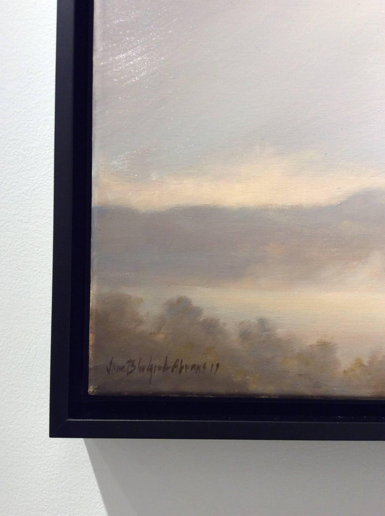 landscape oil painting on canvas 20 x 30 inches in thin black frame  Jane Bloodgood-Abrams highlights the sublime beauty of the Hudson River Valley with this landscape painted from Oak Hill, NY. Dusky pink clouds eclipse a sliver of pale blue sky,