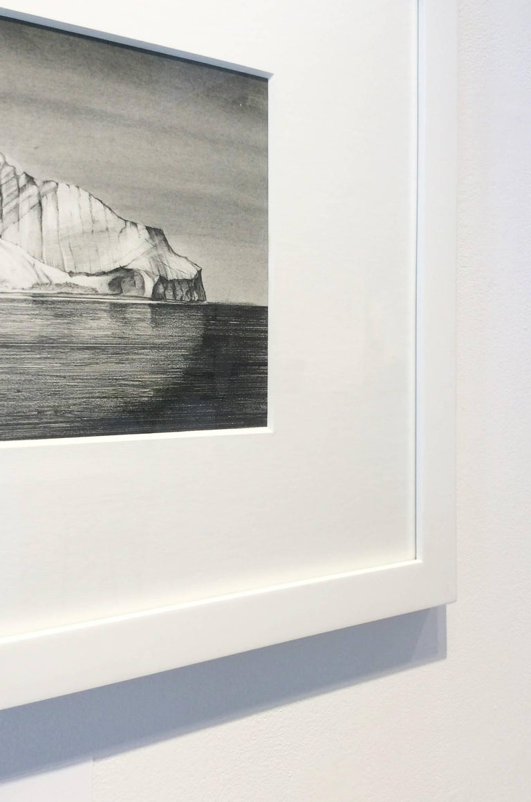 Black and white landscape drawing of a giant iceberg  Graphite on paper in white frame with 8-ply white mat 8 x 10 inches unframed, 18 x 22 inches framed   Unique, contemporary grey scale graphite drawing of an iceberg showing ice above and below a